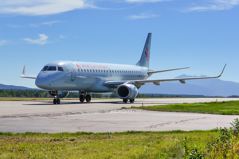 Air Canada Embraer 190 taxies to the gate at Whitehorse International Airport