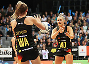 Magic wing defense Hayley Saunders passes to Magic wing attack Ariana Cable-Dixon during the ANZ Premiership netball match - Magic v Pulse played at Claudelands Arena, Hamilton, New Zealand on Sunday 20 May 2018.<br /> <br /> Copyright photo: © Bruce Lim / www.photosport.nz