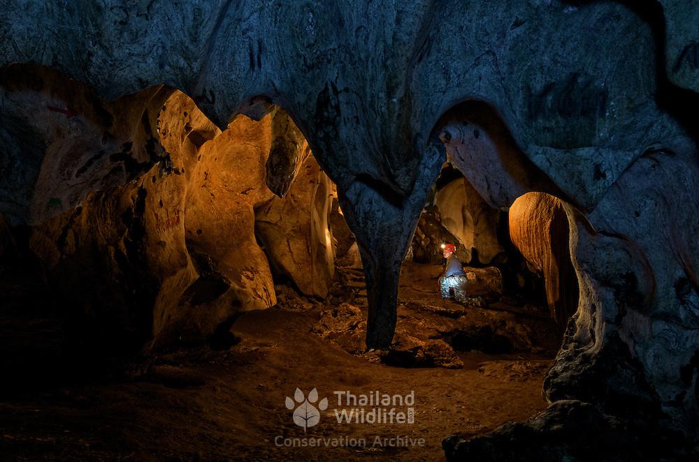 A caver explores the caves of Khao Phraya Phai Rua in Lan Sak, Uthai Thani, Thailand.