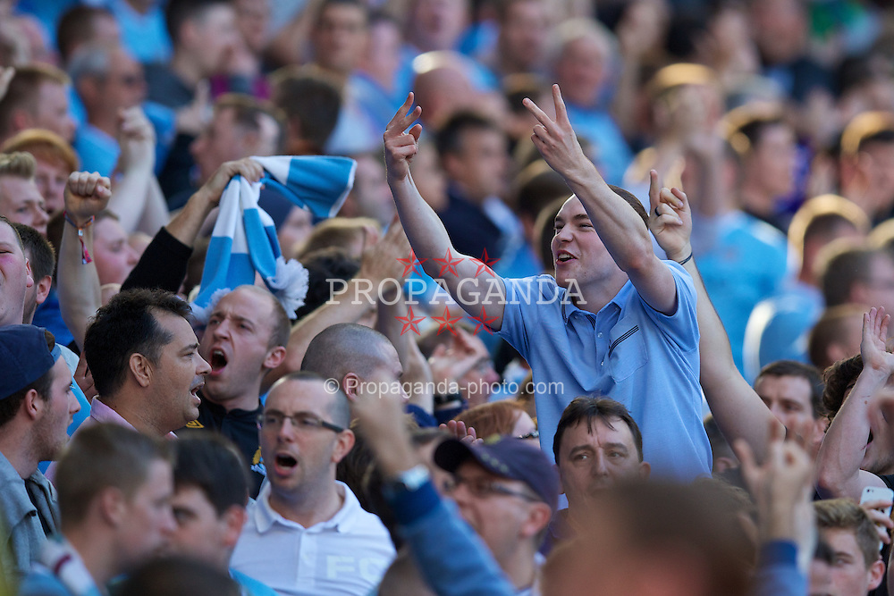 MANCHESTER, ENGLAND - Sunday, September 22, 2013: Manchester City supporters before the Premiership match against Manchester City at the City of Manchester Stadium. (Pic by David Rawcliffe/Propaganda)