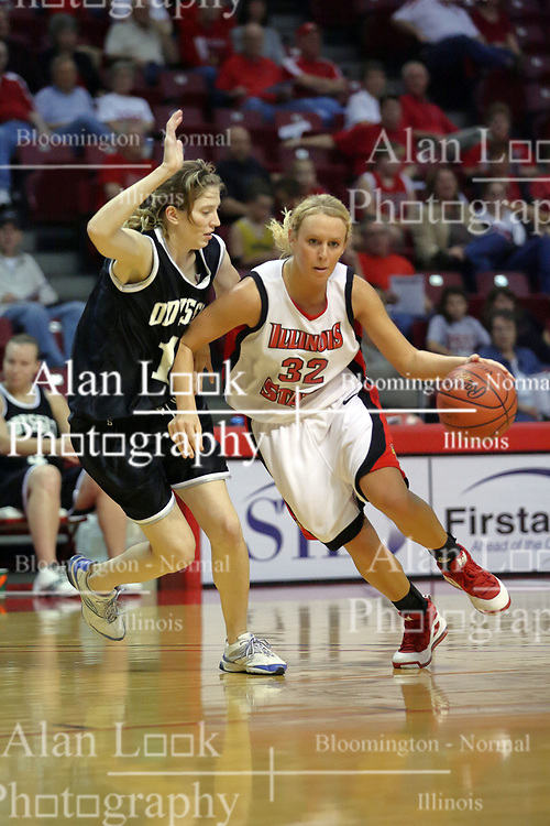 02 November 2008: Maggie Krick drives against Genny Mueller during a game which the Illinois State Redbirds defeated Odyssey on Doug Collins Court inside Redbird Arena in Normal Illinois.