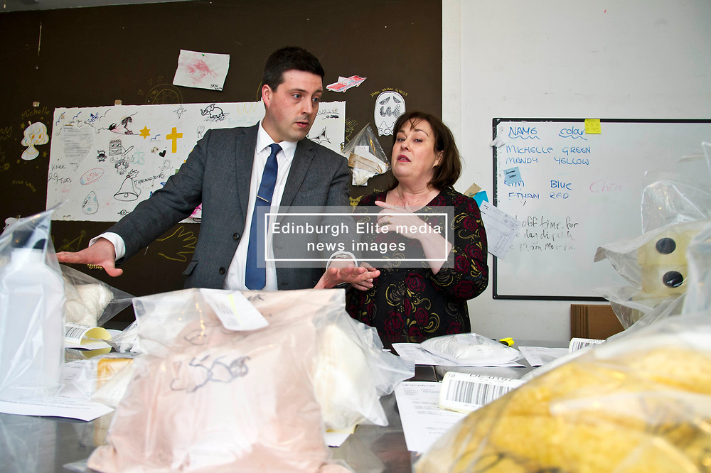 Pictured: Jamie Hepburn is shown some of the ingredients of the soiap produced by Gracefruit by owner Bert Carnahan<br /> <br /> Employability and Training Minister Jamie Hepburn visited soapmaking company Gracefruit today as labour market statistics are published. He met staff who receive the living wage and also heard from the company's owner Beth Carnahan how it is working to address the impact of Brexit and how it is adopting more flexible working model with many staff working around 23 hours per week.<br /> Ger Harley | EEm date