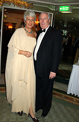 LORD HARRIS OF PECKHAM and his wife DAME PAULINE HARRIS at the Dyslexia Awards Dinner attended by HRH The Countess of Wessex held at The Dorchester Hotel, Park Lane, London on 9th November 2005.<br />