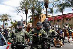 Riot police trying to push protestors back on May 25, 2016 in Anaheim, California.