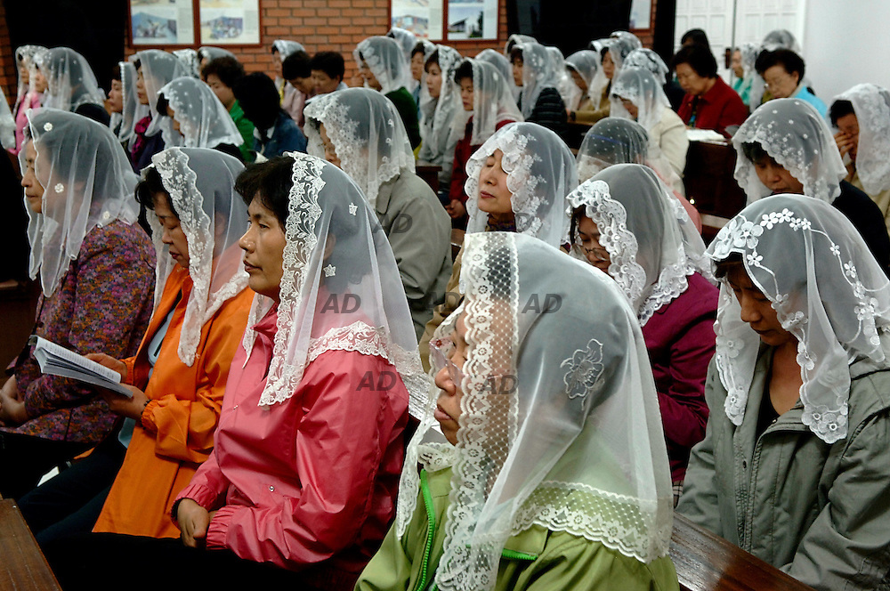 According Associated Press-Ipsos poll of the United States and nine of its allies on religious attitudes, 19 percent of Koreans said they did not believe in God, the highest percentage among nations polled. According to the poll, Buddhism was the most popular religion in Korea with 24 percent of the respondents regarding themselves as its followers. Twenty-three percent and 11 percent identified Protestantism and Catholicism, respectively. Christianity was unkown in the Korean Peninsula before the 18th century. The social composition of the two Christian communities was different as well. The Protestants were by no means an elite group, but they included a large number of the best and brightest. Catholicism, on the contrary, remained the religion of simple, uneducated people, largely farmers and small craftsmen. The Catholics were deeply involved in the change of the regime. In 1974 one of the most radical Catholics, Bishop Chi Hak-sun, was imprisoned for allegedly supporting anti-government activities. The arrest of the bishop was a shock and led to an outpouring of resistance. From that time, the Catholic churches became major strongholds of the opposition. The nationÍs major cathedral, Myngdong Cathedral in Seoul, was the usual place of the democracy rallies, and the priests often signed sharply worded anti-government declarations. Today the Protestant activism gain growth and the percentage is higher than Catholics. *** Local Caption *** Martyr's Shrine at Saenamteo Church was build on a site used as milaty training ground and as execution site During the persecution of Catholics in Korea many priest gave witness to their faith with the death on this site. Among them in 1801 the Chinese pries Mun-mo Chu, the first Catholic priest in Korea.