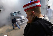 """9/13/03- Highway 75 - Deric (cq) Radermacher, 5, holds his ears to vid the noise as a 1955 Chevy c and its owner ompetes in the """"Burn Out"""" contest  at the car show in Bellingham, MN , part of Boogi-Woogie days in the town, which was planned to co-incide with the Highway 75 King of trails celebration."""