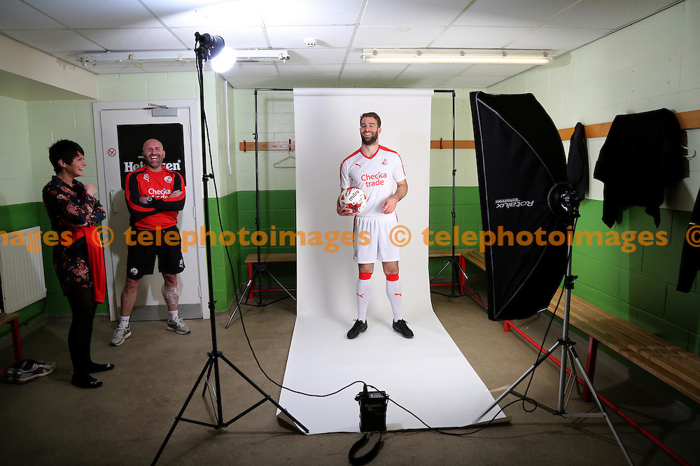 Joe McNerney models Crawley Town FC's new kit for the 2016-17 season at the Checkatrde.com Stadium in Crawley. April 12, 2016.<br /> James Boardman / Telephoto Images<br /> +44 7967 642437