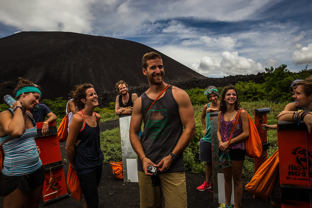 LEON, NICARAGUA - SEPTEMBER 18, 2014: A group of tourists laugh at a joke while learning how the volcano board functions. Guided tours are available from $29 USD to board down the Cerro Negro Volcano, located an hour outside of Leon. PHOTO: Meridith Kohut