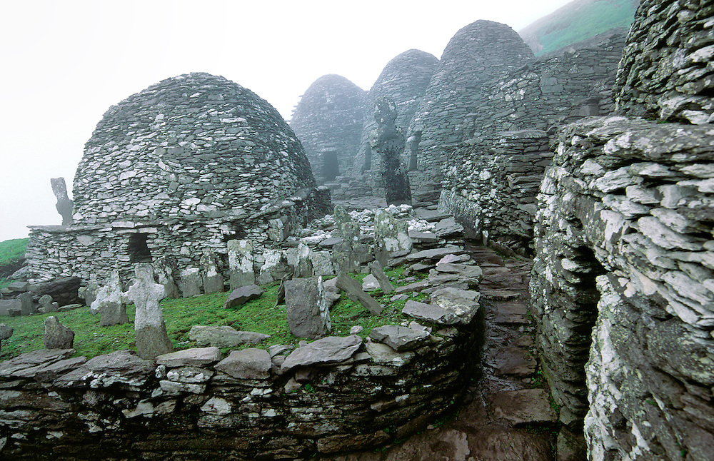 Monastic settlement at top of island of Skellig Michael, County Kerry, Ireland. Monks stone beehive huts and graveyard crosses.