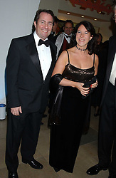 DR LIAM FOX and his fiance JESME BAIRD at a dinner attended by the Conservative leader Michael Howard and David Davis and David Cameron held at the Banqueting Hall, Whitehall, London on 29th November 2005.<br />