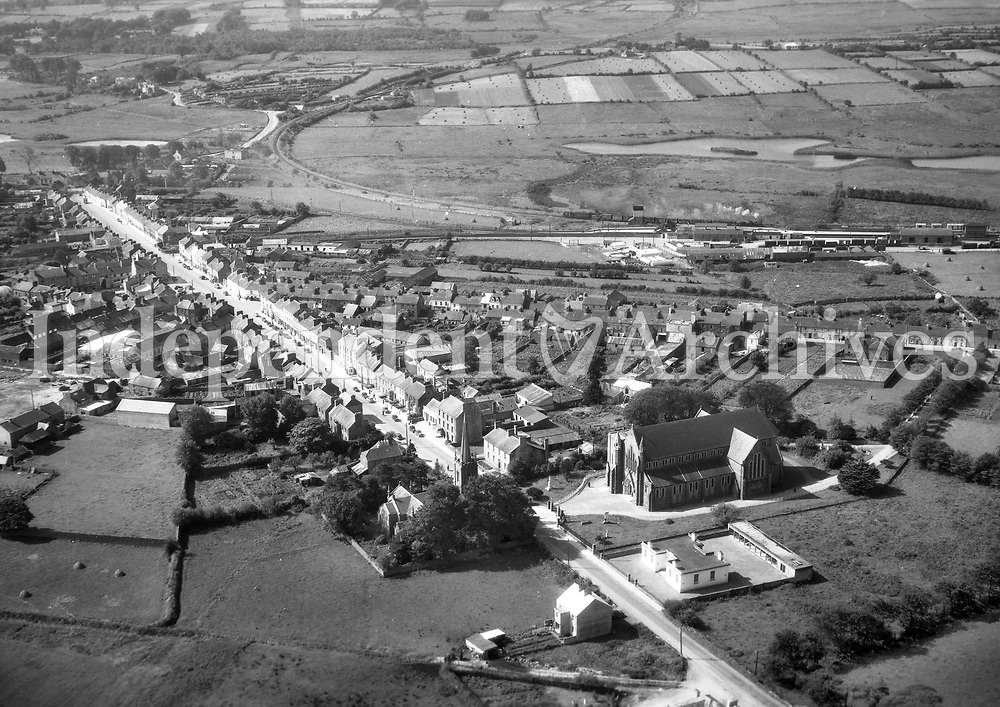 A111 Claremorris.   16/08/57. (Part of the Independent Newspapers Ireland/NLI collection.)<br /> <br /> These aerial views of Ireland from the Morgan Collection were taken during the mid-1950's, comprising medium and low altitude black-and-white birds-eye views of places and events, many of which were commissioned by clients. From 1951 to 1958 a different aerial picture was published each Friday in the Irish Independent in a series called, 'Views from the Air'.The photographer was Alexander 'Monkey' Campbell Morgan (1919-1958). Born in London and part of the Royal Artillery Air Corps, on leaving the army he started Aerophotos in Ireland. He was killed when, on business, his plane crashed flying from Shannon.