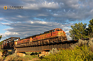 Burlington Northern freight train crosses the Powder River trestle at sunrise near Terry; Montana; USA