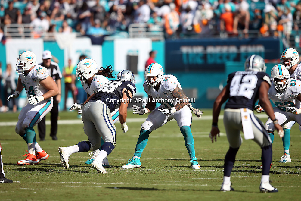 Miami Dolphins center Mike Pouncey (51) blocks Dallas Cowboys defensive tackle Tyrone Crawford (98) during the 2015 week 11 regular season NFL football game against the Dallas Cowboys on Sunday, Nov. 22, 2015 in Miami Gardens, Fla. The Cowboys won the game 24-14. (©Paul Anthony Spinelli)