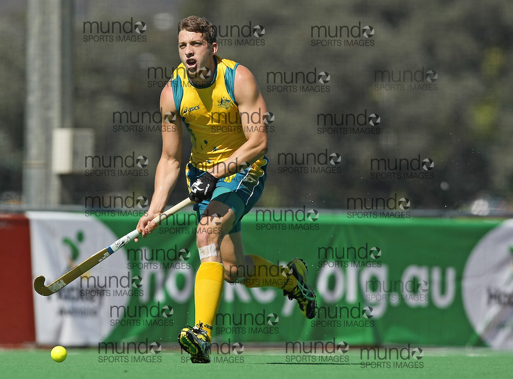 (Canberra, Australia---31 March 2012) Simon Orchard of the Australia Kookaburra national field hockey team playing the second of a three game field hockey test match series between Australia and Japan men's field hockey teams. 2012 Copyright Photograph Sean Burges / Mundo Sport Images.