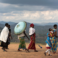 KAYUMBU RWANDA-OCT 11:  A group of women in the Rwandan countryside. Rwanda is the most densely populated country in Africa. There are an estimated 352 people per square kilometer.  35 percent of the population engage in subsistence agriculture and live under the poverty line.  But with a growth rate of 6-8 percent  since 2003 the poverty rate is declining. (Photo by William Campbell-Corbis via Getty Images)