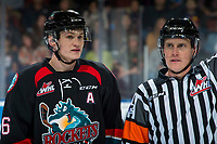 KELOWNA, CANADA - SEPTEMBER 22:  Kaedan Korczak #6 of the Kelowna Rockets stands on the ice next to referee Ward Pateman against the Kamloops Blazers on September 22, 2018 at Prospera Place in Kelowna, British Columbia, Canada.  (Photo by Marissa Baecker/Shoot the Breeze)  *** Local Caption ***