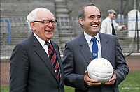 Harry Cavan, president, Irish Football Association, left, and Brian Mawhinney, Junior N Ireland Minister, in convivial mood at a press conference at Windsor Park, the home gound of Linfield FC and the N Ireland International team. 19860403HC+BW.<br />