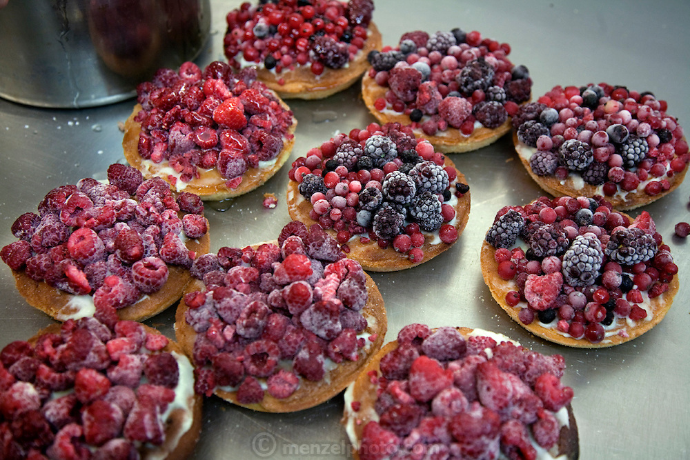 Tarts topped with frozen berries at Bastian's Restaurant and Bakery in Cologne, Germany, where Bread Queen Robina Weiser-Linnartz works as a baker and pastry chef. (From the book What I Eat: Around the World in 80 Diets.)
