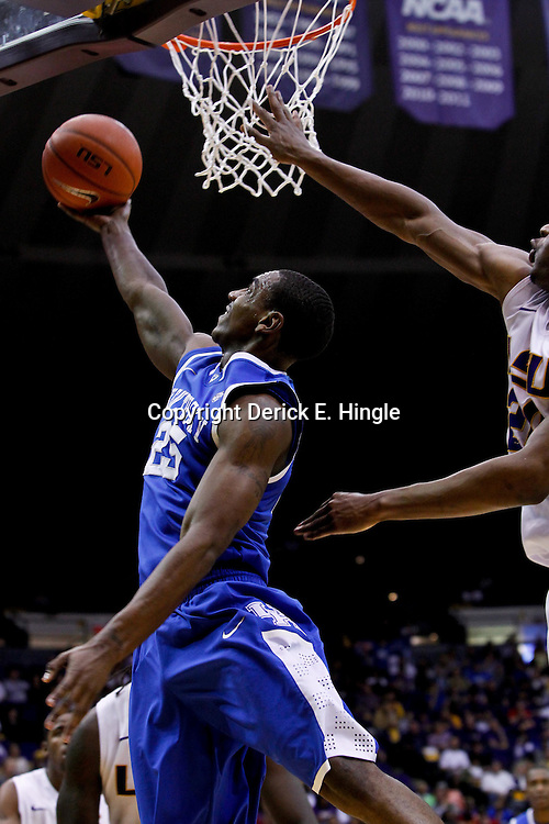 January 28, 2012; Baton Rouge, LA; Kentucky Wildcats guard Marquis Teague (25) shoots over LSU Tigers forward Storm Warren (24) during the second half of a game at the Pete Maravich Assembly Center. Kentucky defeated LSU 74-50.  Mandatory Credit: Derick E. Hingle-US PRESSWIRE