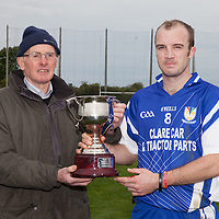 Patsy McGoff presenting the Division 2 Hurling League Cup to the Kilmaley Captain, Kenneth Kennedy