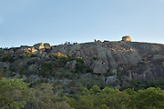 A long, steep granite escarpment in Matobo National Park, part of the Motopos Hiils area in Zimbabwe. The park is an U.N. UNESCO World Hertiage Site. © Michael Durham / www.DurmPhoto.com
