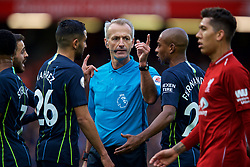 LIVERPOOL, ENGLAND - Sunday, October 7, 2018: Manchester City's Riyad Mahrez (L) and Fernando Luiz Roza 'Fernandinho' (R) challenge referee Martin Atkinson during the FA Premier League match between Liverpool FC and Manchester City FC at Anfield. (Pic by David Rawcliffe/Propaganda)