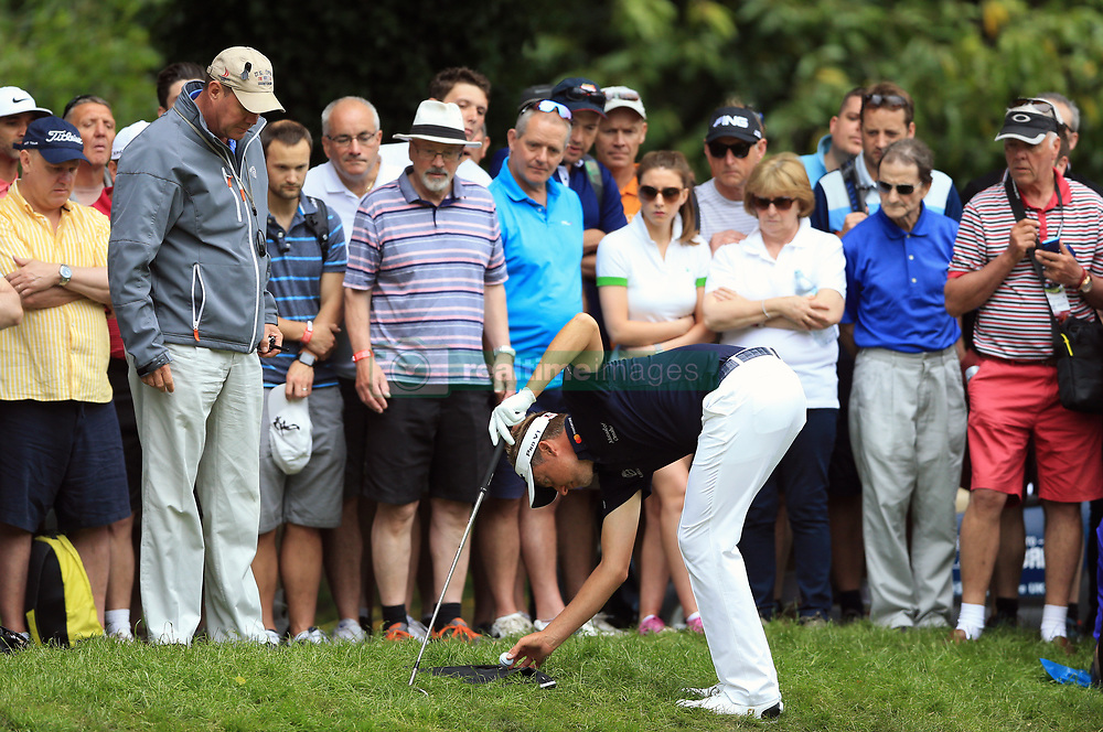 England's Ian Poulter after his ball lands on a spectators bag on the third hole during day three of the 2017 BMW PGA Championship at Wentworth Golf Club, Surrey.