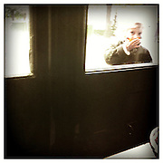 10-5-11 --- A curious girl peeks through the window of a restaurant.