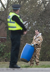 © Licensed to London News Pictures. 15/03/2018. Alderholt, UK. Military personnel are seen carrying plastic drums at an address in Alderholt, Dorset, believed to be the home of Wiltshire Police Detective Sergeant Nick Bailey, in connection with the poisoning of Former Russian spy Sergei Skripal and his daughter Yulia were. The couple where found unconscious on bench in Salisbury shopping centre. Photo credit: Ben Cawthra/LNP