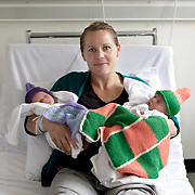 Oslo, Norway, August 27, 2012. Helle, Norwegian, with her twins Oskar and Lasse, 1 day old. Maternity Ward, Ulleval Hospital in Oslo, the largest in Norway.