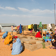 Family members doing laundry for patients at a Médecins Sans Frontières (MSF) health centre in the Mbera refugee camp for Malian refugees in southeastern Mauritania on 3 March 2013.