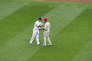 Brian Dozier #2 of the Minnesota Twins talks with former Minnesota Twin Ben Revere #2 of the Philadelphia Phillies before a game on June 11, 2013 at Target Field in Minneapolis, Minnesota.  The Twins defeated the Phillies 3 to 2.  Photo: Ben Krause