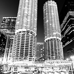 Chicago Marina City Towers at night black and white picture. Marina City is a residential complex of two round buildings along the Chicago River in downtown Chicago.