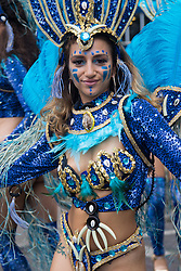London, August 29th 2016. Revealing feathered costumes and loud music make for a heady atmosphere during day two of Europe's biggest street party, the Notting Hill Carnival.