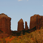 Cathedral Rock is a famous landmark on the Sedona, skyline. It is located in the Coconino National Forest in Yavapai County. Sedona straddles the county line between Coconino and Yavapai counties in the northern Verde Valley, Arizona. Sedona's main attraction is its array of red sandstone formations that appear to glow in brilliant orange and red when illuminated by the rising or setting sun. It was named after Sedona Arabella Miller Schnebly (1877–1950) <br /> Photography by Jose More