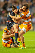 Simon Hickey (#10) of Edinburgh Rugby is tackled by Benhard van Rensburg (#13) of Toyota Cheetahs during the Guinness Pro 14 2018_19 match between Edinburgh Rugby and Toyota Cheetahs at BT Murrayfield Stadium, Edinburgh, Scotland on 5 October 2018.