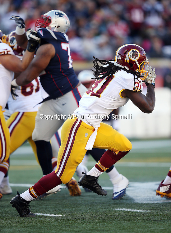 Washington Redskins running back Matt Jones (31) runs the ball during the 2015 week 9 regular season NFL football game against the New England Patriots on Sunday, Nov. 8, 2015 in Foxborough, Mass. The Patriots won the game 27-10. (©Paul Anthony Spinelli)