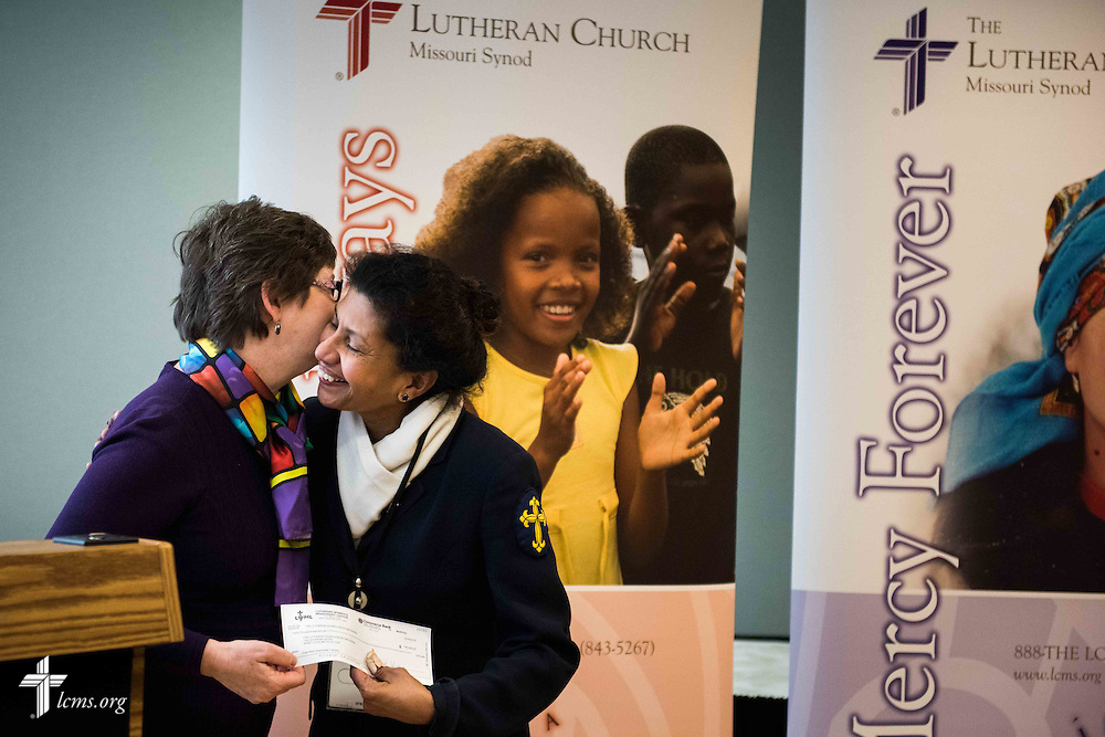 From left, Shelley Moeller, LWML vice-president of Gospel Outreach, presents Deaconess Grace Rao with a check for a grant awarded to LCMS Deaconess Ministry, at the LCMS International Center on Wednesday, Jan. 6,  2016 jn Kirkwood, Mo. LCMS Communications/Frank Kohn