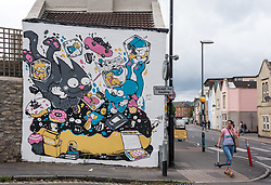 © Licensed to London News Pictures.  30/07/2018; Bristol, UK. Work by artist Bao on the theme of the Simpsons animated series. Works completed or nearing completion on the third and final day of Upfest, The Urban Paint Festival, 2018 with themes this year including the Simpsons cartoon series and 100 years of the first women getting the vote. Upfest which is Europe's largest Street Art and Graffiti Festival takes place in the Bedminster area of Bristol between Saturday the 28th and Monday 30th of July. In celebration of their 10th anniversary, Upfest will feature the animated family, The Simpsons with 2018 festival goers treated to artist interpretations including Homer, Marge, Bart, Lisa, and Maggie. The festival has also teamed up with Bristol Women's Voice to celebrate the centenary of the first votes for women, and together Upfest and Bristol Women's Voice will celebrate the progress made since 1918, with three artists including Nomad Clan chosen to portray the suffrage movement and the rights of women. Upfest will have 400 artists from 70 countries in attendance, and this year three Upfest artists have been selected by The Simpsons creator Matt Groening to bring The Simpsons to life in their own unique styles: Bao, born and based in Hong Kong, is known for her freestyle work with vibrant murals and illustrations; Soker, a wildstyle writer, is one of Bristol's finest talents and has been putting his mark on the city since the late 80's; Nomad Clan, the collective of Cbloxx and AYLO, one of the most sought-after duos in the international global street art scene. Upfest will be raising money for The National Association for Children of Alcoholics (NACOA) which offers aid and assistance for children growing up in families affected by alcoholism. Photo credit: Simon Chapman/LNP