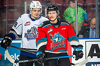 KELOWNA, BC - NOVEMBER 20: Brandon Cutler #29 of the Victoria Royals talks at Michael Farren #16 of the Kelowna Rockets as they line up for the puck drop at Prospera Place on November 20, 2019 in Kelowna, Canada. (Photo by Marissa Baecker/Shoot the Breeze)
