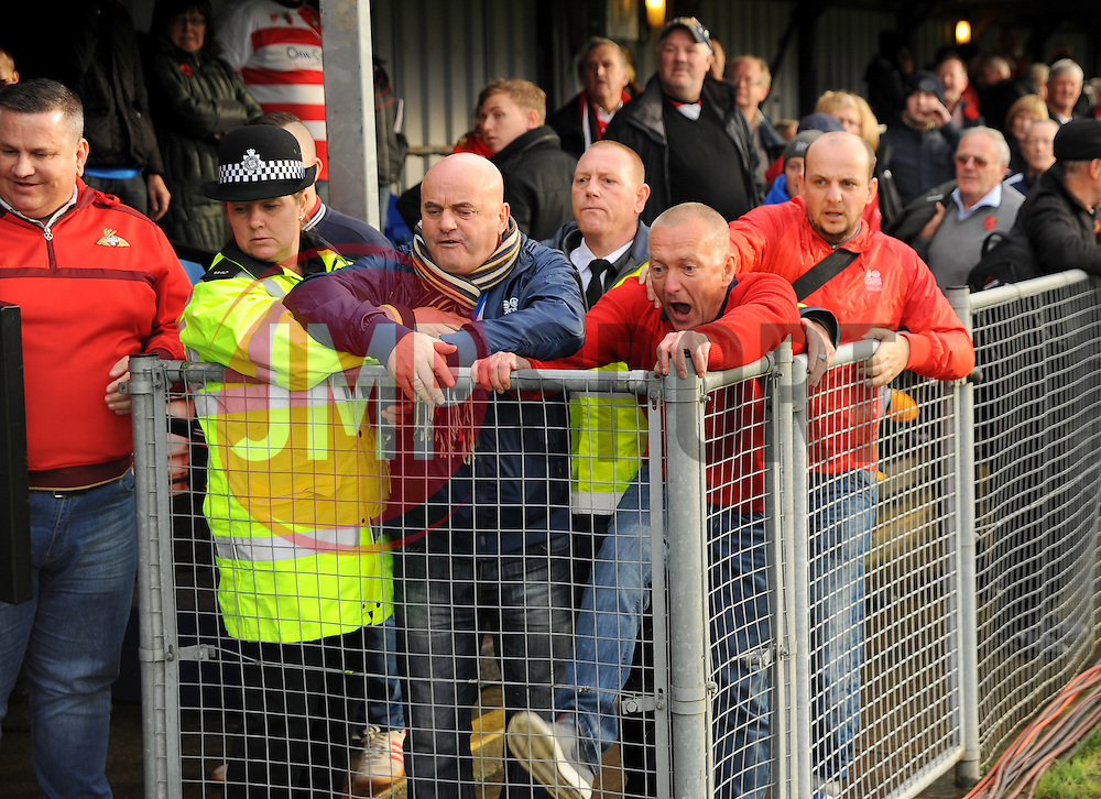 Doncaster Rovers' Fans show there frustration as the match is postponed - Photo mandatory by-line: Nizaam Jones - Mobile: 07583 387221 - 08/11/2014 - SPORT - Football - Weston-super-Mare - Woodspring Stadium - WSM v Doncaster - Sport - Round One