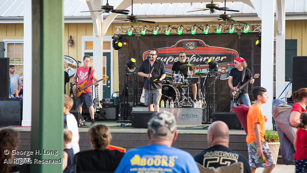 Supercharger preforms on the Abita Beer Stage as people gather in Abita Springs Park before fireworks on July 2, 2017