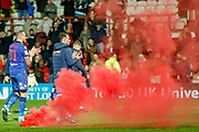 A red flare thrown on the pitch after the EFL Sky Bet Championship match between Brentford and Bolton Wanderers at Griffin Park, London, England on 22 December 2018.