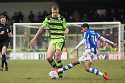 Colchester United's Brandon Comley(14) tales Forest Green Rovers Haydn Hollis during the EFL Sky Bet League 2 match between Forest Green Rovers and Colchester United at the New Lawn, Forest Green, United Kingdom on 2 April 2018. Picture by Shane Healey.