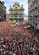 Participants celebrate during the 'Chupinazo' to mark the start at noon sharp of the San Fermin Festival on July 6, 2012 in front of the Town Hall of Pamplona, northern Spain. Tens of thousands of people packed Pamplona's streets for a drunken kick-off to Spain's best-known fiesta: the nine-day San Fermin bull-running festival. PHOTO / Rafa Rivas