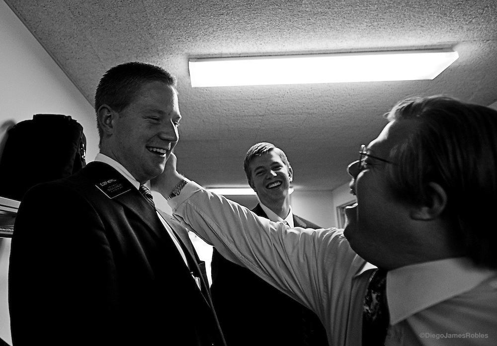 Elder Merrill, left, and Balls share a laugh with a mentally handicapped member of the church, in The Plains, Ohio, on Sunday morning, May 25, 2008.