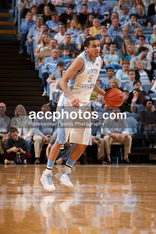 CHAPEL HILL, NC - FEBRUARY 22: Marcus Paige #5 of the North Carolina Tar Heels plays against the Wake Forest Demon Deacons on February 22, 2014 at the Dean E. Smith Center in Chapel Hill, North Carolina. North Carolina won 105-72. (Photo by Peyton Williams/UNC/Getty Images) *** Local Caption *** Marcus Paige