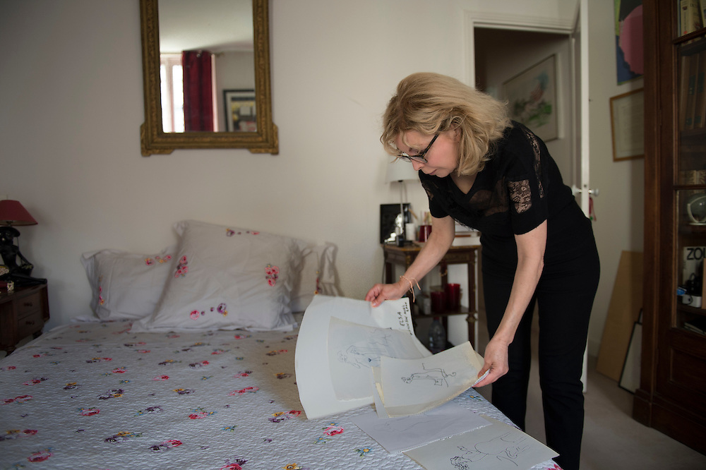 March 6, 2015, Paris, France. Writer Maryse Wolinski (1943, Algiers), in the bedroom of her Paris' apartment, shows a drawing made by her husband Georges Wolinski (1934-2015), a French artist who often portrayed her. After the Islamist terrorist attack on Charlie Hebdo and his death,  two month earlier, Maryse Wolinski deals with loss. The cartoonist Georges Wolinski was 80 years old when he was murdered by 2 jihadists, he was one of the 12 victims of the massacre in the Charlie Hebdo offices on January 7, 2015 in Paris, after publishing caricatures of Mohammed, considered blasphemous by some Muslims. Georges Wolinski defended freedom, secularism and humour and was one of the major political cartoonists in France. The couple was married and lived since 47 years together. Photo: Steven Wassenaar.