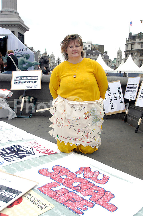 Disability Rights Festival; organised by Greater London Authority; Trafalgar Square; London Sep 2006, Campaigner from disability rights group Our Lives Are For Living with handwritten & handsewn pillowcases about life for disabled people; They were asking people to write their own comments to add to the banner