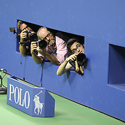 Photographers attempt to shoot Novak Djokovic, Serbia, as he celebrates with his team and coach Boris Becker after winning the Men's Singles Final against Roger Federer, Switzerland, during the US Open Tennis Tournament, Flushing, New York, USA. 13th September 2015. Photo Tim Clayton